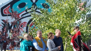 The Duke and Duchess of Cambridge receive a eagle feather from a young girl in Carcross, Yk, Wednesday, Sept 28, 2016. THE CANADIAN PRESS/Jonathan Hayward
