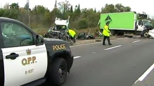 Transport truck and SUV collide on Highway 401 early Thursday, September 29, 2017
