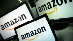 The Amazon logo is seen on TV screens. (AFP / Leon Neal)