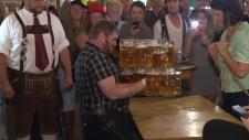 Steve Richtaritsch carries steins of beer