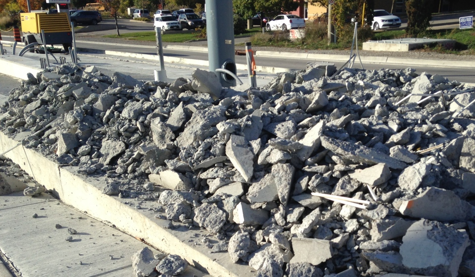 Broken up concrete is seen at an Ion stop on Thursday, Oct. 13, 2016. (Tyler Calver / CTV Kitchener)