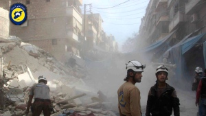 In this picture provided by the Syrian Civil Defense group known as the White Helmets, Syrian Civil Defense workers search through the rubble in rebel-held eastern Aleppo, Syria, Wednesday, Oct. 12, 2016. (Syrian Civil Defense- White Helmets via AP)