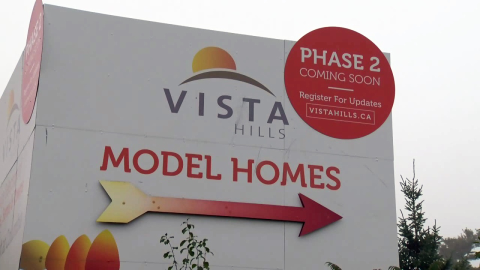 A sign advertises new homes for sale in Waterloo's Vista Hills subdivision.