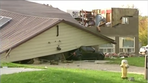 Car crushed by roof in storms on Monday, Oct 16