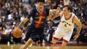 San Lorenzo de Almagro's Gustavo Nicolas Aguirre, left, gets position on Toronto Raptors' Brady Heslip during the second half of their NBA pre-season game Friday October 14, 2016 in Toronto. (THE CANADIAN PRESS/Jon Blacker)