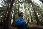 Ken Wu, of the Ancient Forest Alliance, speaks to a group of educational tour guides during training for Chinese-language ancient forest tours, at Stanley Park in Vancouver on Saturday, October 22, 2016. (Darryl Dyck / THE CANADIAN PRESS)