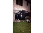 A black Dodge pickup crashed into the Mexican Consulate in Leamington on Sunday, October 23, 2016. (Courtesy OPP)