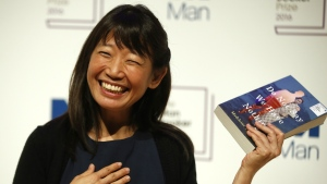 "Writer Madeleine Thien, poses for the media with her book ""Do Not Say We Have Nothing"" during a photocall for the 6 shortlisted authors for the Man Booker Prize for fiction in London, Monday, Oct. 24, 2016. (AP / Alastair Grant)"