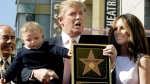 Donald Trump, with Melania Trump and their son Barron on the Hollywood Walk of Fame in L.A., on Jan. 16, 2007. (Damian Dovarganes / AP)