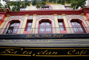 A man appears on a balcony of the renovated facade of the Bataclan concert hall in Paris, Friday, Oct.28, 2016. (AP Photo/Christophe Ena)