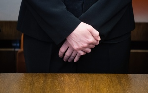 Defendant midwife, only identified as Regina K., stands on trial at the state court in Munich, southern Germany, Friday, Oct. 28, 2016. The court has convicted her on seven counts of attempted murder and sentenced her to 15 years in prison for secretly giving blood thinners to women shortly before they were to give birth by cesarean section. (Matthias Balk/dpa via AP)