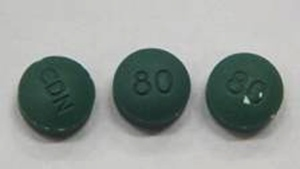 Pills that resemble OxyContin, with the imprints of 'CDN' and '80' on opposite sides, are shown here. (Waterloo Regional Police)