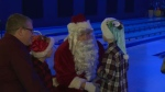 Santa visits kids at bowling alley