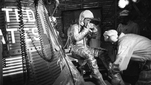 FILE - In this Feb. 20, 1962, file photo, astronaut John Glenn sits next to the Friendship 7 space capsule atop an Atlas rocket at Cape Canaveral, Fla., during preparations for his flight which made him the first American to orbit the Earth. (AP Photo/File)
