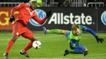 Seattle Sounders defender Chad Marshall and Toronto FC forward Jozy Altidore, left, battle for a ball during extra time MLS Cup final action in Toronto on Saturday, Dec. 10, 2016. (THE CANADIAN PRESS / Frank Gunn)