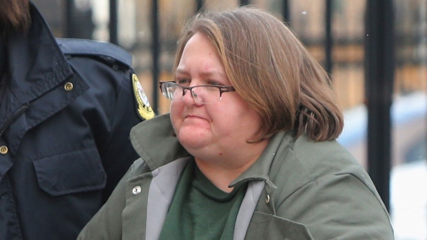 Elizabeth Wettlaufer is escorted into the courthouse in Woodstock, Ontario on Friday, Jan. 13, 2017. THE CANADIAN PRESS/Dave Chidley