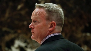 Sean Spicer, Republican National Committee communications director and chief strategist, waits for an elevator as he arrives at Trump Tower, Wednesday, Nov. 16, 2016, in New York. (AP Photo / Carolyn Kaster)