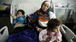 Um Yousef and her two young daughters recover in an Irbil hospital after they were badly injured in a mortar attack outside their home in Mosul, Iraq on Sunday Jan. 15, 2017. (AP / Susannah George)