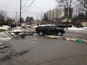 Various items from a trailer spilled onto the roadway following a collison on Belmont Avenue near Queen's Boulevard on Wednesday, Jan. 18, 2017. (Dan Lauckner / CTV Kitchener)