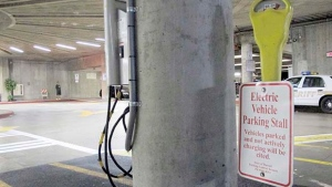 An electric vehicle charging station awaits a vehicle in the parking lot at the Hawaii State Legislature on Wednesday, Jan. 18, 2017 in Honolulu. (AP Photo/Cathy Bussewitz)