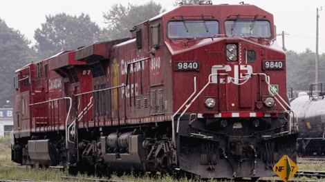 CP Rail engines sit along a siding in North Vancouver Wednesday July 18, 2007. (CP PHOTO/Chuck Stoody)