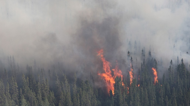 A forest fire burns near Timmins, Ont., on Thursday, May 24, 2012. (Ontario Ministry of Natural Resources-Christine Rosche)