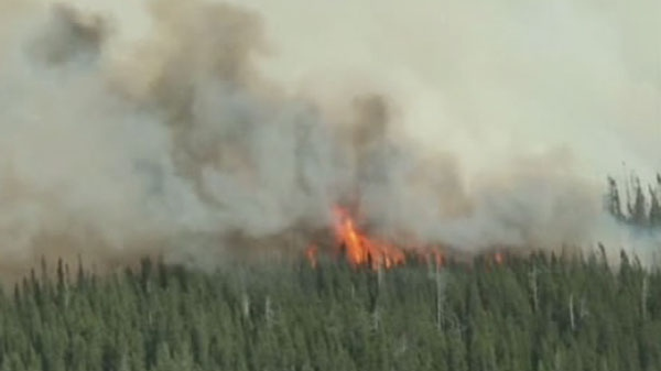 This photo from video shows a forest fire near Timmins, Ont. on May 26, 2012.
