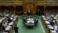 MPPs sit in the Ontario legislature ahead of a vote on the provincial budget.