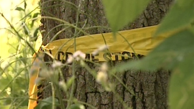Yellow tape is seen at a property where a native burial ground was found in Brantford, Ont., Tuesday, July 10, 2012.