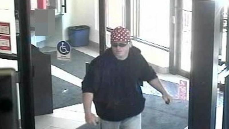 A suspect sought in connection with a robbery at the Scotiabank on Doon Village Road in Kitchener, Ont. is seen in this surveillance image captured May 14, 2012. (Courtesy Waterloo Regional Police Service)
