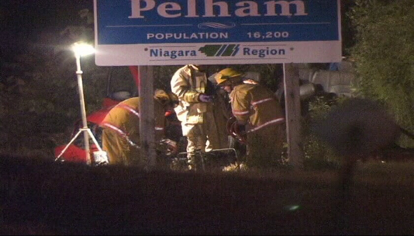 First responders attempt to save passengers involved in fatal crash in Pelham, Ont., on Friday, July 13, 2012.