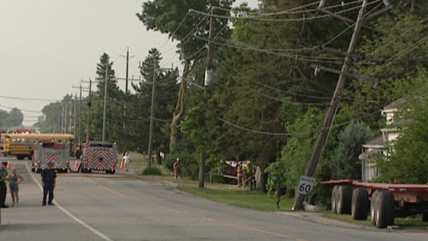 Damage is seen following a crash in Petersburg, Ont.