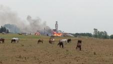 Firefighters battle a blaze at a woodworking shop