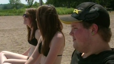 Young people at the beach at Laurel Creek Conservation Area in Waterloo, Ont.