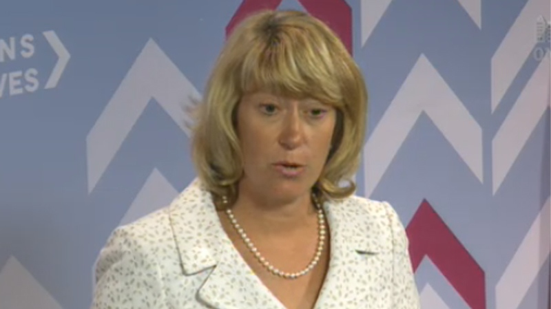 Ontario Education Minister Laurel Broten speaks with the media on July 30, 2012.