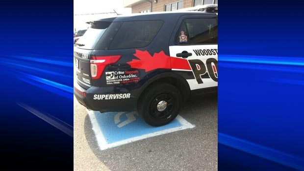 A Woodstock police cruiser is seen stopped in a handicap spot at a truck stop on Tuesday, July 31, 2012, in this image submitted to MyNews.
