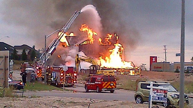 Firefighters battle a blaze in Waterloo, Ont. on Thursday, Aug. 9, 2012.