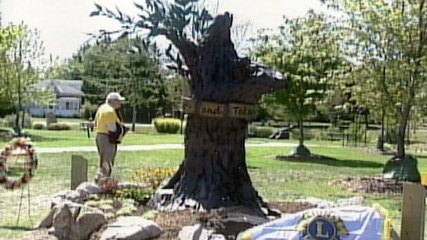 A bronze monument is seen a year after the tornado in Goderich, Ont. on Tuesday, Aug. 21, 2012.