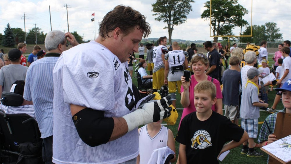 The CFL's Hamilton Tiger-Cats practiced and chatted with fans at Warrior Field in Waterloo, Ont. on Tuesday, Aug. 28, 2012.