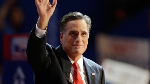 Republican presidential nominee Mitt Romney waves to delegates after his speech at the Republican National Convention in Tampa, Fla., on Thursday, Aug. 30, 2012. (AP / Charlie Neibergall)