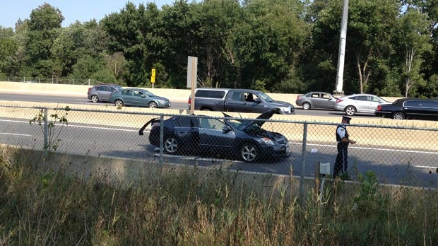 An OPP officer is seen at the location of a multi-vehicle collision on HIghway 7/8 in Kitchener, Ont. on Friday, Aug. 31, 2012.