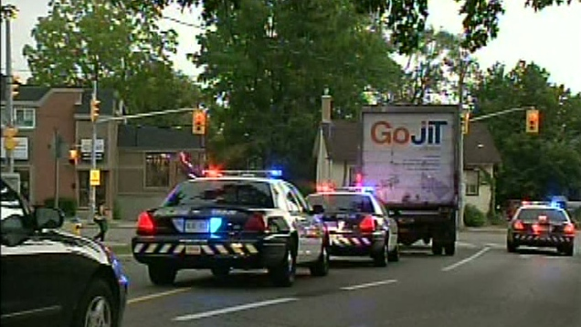 A cube van believed to be involved in a fatal pedestrian collision is seen in Waterloo, Ont. on Tuesday, Sept. 4, 2012.