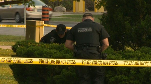 Police investigate following a fatal shooting on Belmont Avenue in Kitchener, Ont. on Friday, Sept. 7, 2012.
