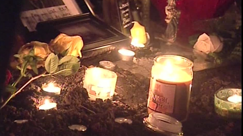 Candles are lit at a makeshift memorial for shooting victim Adam Tyler Jones in Kitchener, Ont. on Friday, Sept. 8, 2012.
