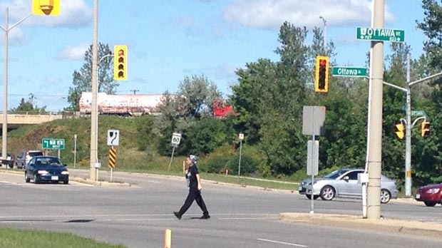 A pedestrian crosses the street at Ottawa Street and Homer Watson Boulevard in Kitchener, Ont. on Monday, Sept. 10, 2012.