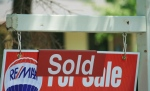 A house 'sold' sign is shown in Oakville, Ont., Monday, July 23, 2012. (Richard Buchan/The Canadian Press)