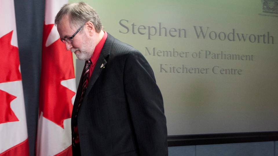 Kitchener MP Stephen Woodworth leaves a news conference after speaking about his motion to study the definition of the human being during a news conference in Ottawa, Monday, Sept. 17, 2012. (Adrian Wyld / THE CANADIAN PRESS)