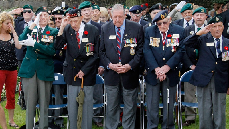 Left to right, Dieppe veterans Fred Engelbretch, 92, Arthur Rossel, 92 of Brampton in Ontario, Roy Wozniak, 93, Russ Burrows, 93 of Picton in Ontario, and David Lloyd Hart, 95 are seen during the commemorations to honor Allied soldiers killed 70 years ago in a failed World War II invasion, in Dieppe, northern France, Sunday Aug. 19, 2012. (AP Photo/Michel Spingler)