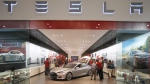 The Tesla showroom is shown at the Washington Square Mall in Portland, Ore. on Friday, July 20, 2012. (AP / Rick Bowmer)